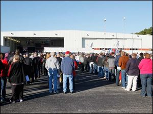 People lineup to attend a campaign rally for  Republican vice-presidential candidate Paul Ryan, in a Grand Aire hangar at Toledo Express Airport.