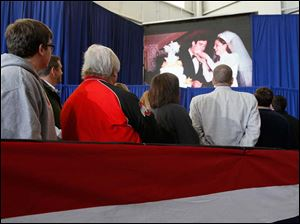 Supporters watch as a video about Republican presidential candidate Mitt Romney is played during a campaign rally featuring his running mate Paul Ryan.
