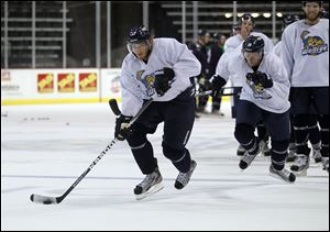 Captain Kyle Rogers moves the puck during training camp. Rogers was second on the team with 44 points, including 20 goals.