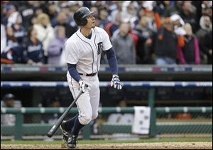 Detroit Tigers' Don Kelly watches his game-winning sacrifice fly to score teammate Omar Infante during the ninth inning of Game 2 on Sunday.