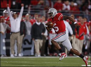 Ohio State quarterback Braxton Miller scores a touchdown against Nebraska on Saturday in Columbus. By winning the highest-scoring game at Ohio Stadium since 1950, OSU (6-0, 2-0 Big Ten) remained the conference's last unbeaten team, matched its win total from last season, and rose four spots to No. 8 in the AP poll. But more important to coach Urban Meyer, the night represented the first time his vision for the Buckeyes' no-huddle spread offense began to come to life.
