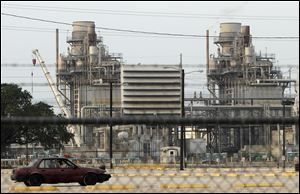 A car enters an employee parking lot at BP's Texas City refinery in Texas City, Texas. BP announced that it has found a buyer for its Texas City refinery, one of the largest and most complex in the U.S.
