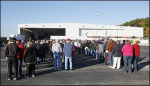 People lineup to attend a campaign rally for  Republican vice-presidential candidate Paul Ryan, in a Grand Aire hangar at Toledo Express Airport near Swanton. Ryan is the running mate of presidential candidate Mitt Romney.