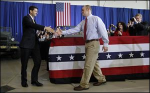 Republican vice-presidential candidate Paul Ryan shakes hands with retired U.S. Army Sgt. Ryan Mack of Defiance after Mack introduced Mr. Ryan.  Mack was injured while serving in Afghanistan.