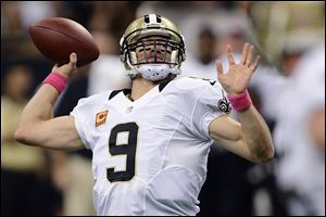 New Orleans Saints quarterback Drew Brees (9) throws a touchdown pass for his 48th consecutive game, breaking Johnny Unitas' NFL record which stood for over 50 years.