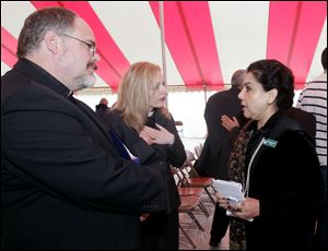 The Rev. Martin Otto Zimmann, left, his wife, Rev. Angela Zimmann, Ph.D., and Dr. Mahjabeen Islam, president of the Islamic Center of Greater Toledo, talking after the event. Over 600 people come together in a