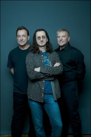 Rush members, from left, Neal Peart, Geddy Lee, and Alex Lifeson.