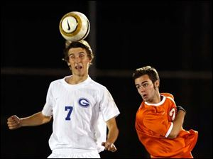 Anthony Wayne's Nick Frank hits the ball with his head against Sylvania Southview's Daniel Blackmar.