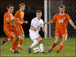 Anthony Wayne's Ben Conkin (11) moves the ball against Sylvania Southview's Mitchell Lestrange (20).