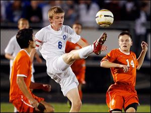 Anthony Wayne's Eddy Wild kicks the ball against.