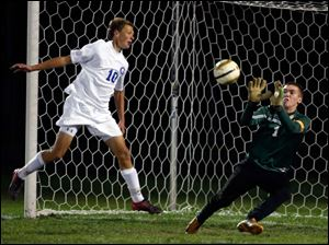 Sylvania Southview goalie Eric Breeden blocks a shot by Anthony Wayne's JJ Fortner.
