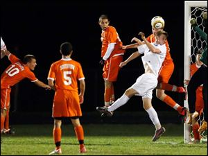Anthony Wayne's Ben Conkin (11) takes a shot against Sylvania Southview goalie Eric Breeden.