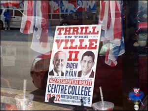A sign in a business window touts the vice presidential debate at Centre College in downtown Danville, Ky.
