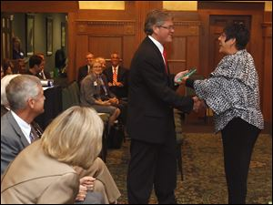 WTVG-TV reporter Bill Hormann accepts his Excellence in Journalism award from Kim Sidwell.