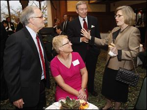 From left: WTVG-TV's Brian Trauring and his wife Linette converse with John and Barbara Cochran during the 2012 Touchstone Awards at the Toledo Club.