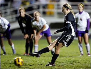 Perrysburg's Maddy Williams scores a goal on a penalty kick.