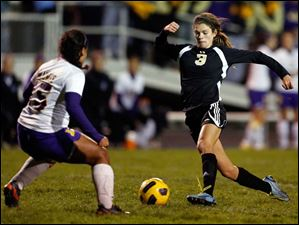 Perrysburg's Courtney Clody (3) moves the ball against  Maumee's Victoria Dameron.