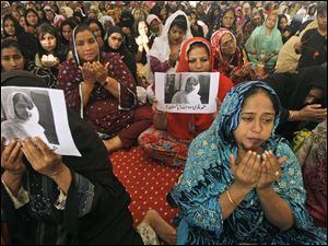 Supporters of Pakistani political party Muttahida Qaumi Movement, chant prayers in support of 14-year-old schoolgirl Malala Yousufzai, who was shot on Tuesday by the Taliban for speaking out in support of education for women.