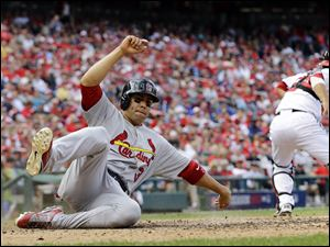St. Louis Cardinals' Carlos Beltran slides into home plate.