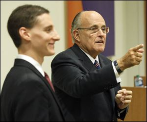 Former New York City Mayor Rudy Giuliani, right, speaks to Toledo-area supporters with Ohio State Treasurer Josh Mandel, left, during a roundtable discussion at  Health Care REIT.