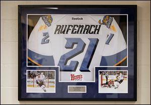 A jersey of Bryan Rufenach is displayed in the locker room. The former Walleye died June 4 in Switzerland.