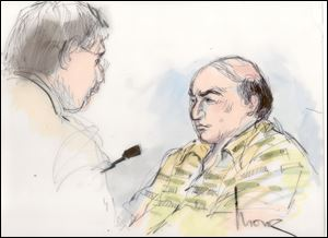 This Sept. 27 file courtroom sketch shows Mark Basseley Youssef, right, talking with his attorney Steven Seiden in court.