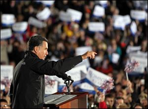 Republican Presidential candidate Mitt Romney talks to the crowd Tuesday in Cuyahoga Falls.