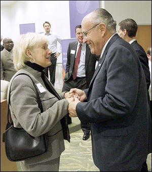 Former Toledo mayor Donna Owens, left, speaks with Former New York City Mayor Rudy Giuliani after a roundtable discussion Wednesday at  Health Care REIT.
