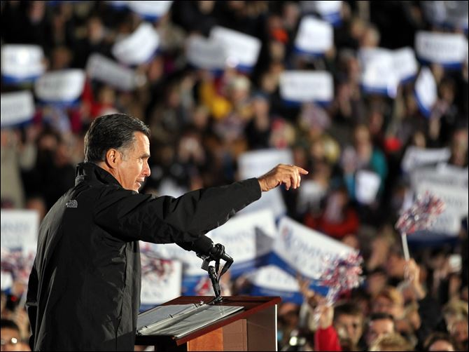Romney cuyahoga falls Republican Presidential candidate Mitt Romney talks to the crowd Tuesday in Cuyahoga Falls.