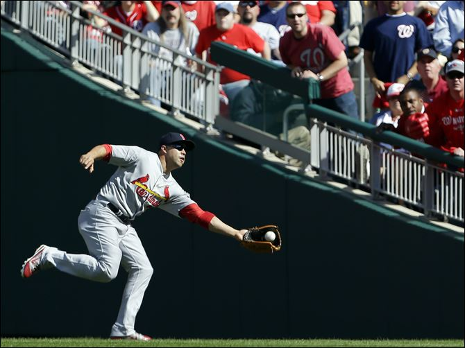 St. Louis Cardinals right fielder Carlos Beltran catches a fly ball Wednesday in Washington.