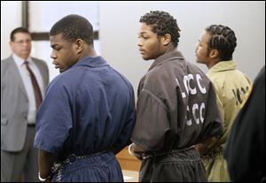 From left to right, Antwaine Jones, James Moore, and Keshawn Jennings, appear in Lucas County Common Pleas Court on Thursday.