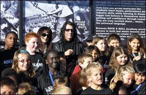 Heavy metal icon Alice Cooper, rear center right, helped open a 6,000-square-foot rock 'n' roll academy that will be open exclusively to club members.