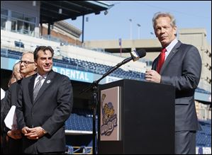 Randy Oostra President and CEO at ProMedica Health System, at podium, along with  the ECHL, and the Toledo Walleye, announce plans to hold a Winterfest and outdoor hockey game at Fifth Third Field.  Walleye president and general manager Joe Napoli looks on, left.