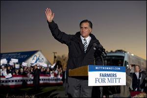 Republican presidential candidate Mitt Romney waves during a campaign rally Wednesday at the Shelby County Fairgrounds in Sidney, Ohio.