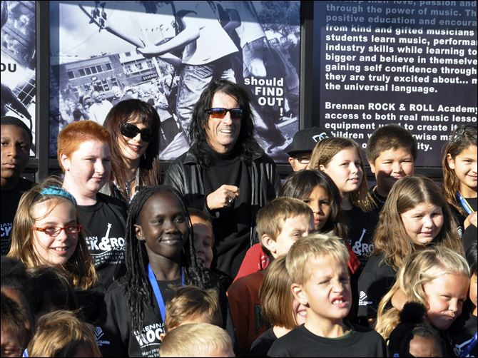 Heavy metal icon Alice Cooper, rear center right, helped open a 6,000-square-foot rock 'n' roll academ