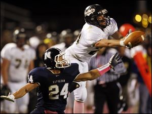 Napoleon C Charlie Harris (24) breaks up a pass intended for  Perrysburg WR Austin Bishop (23).