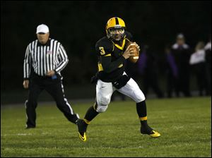 Kyle Kremchek, of the Northview Wildcats, prepares to pass the ball.