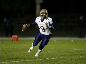 Steve Duby, of the Maumee Panthers, prepares to pass the ball.