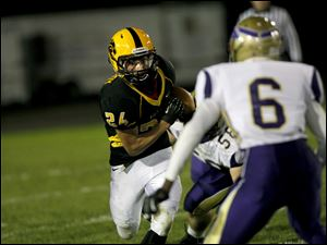 Preston McCurdy, of the Northview Wildcats, runs the ball.