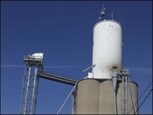 Farmers line up to dump soy beans, corn and wheat at the Mid-Wood Inc. grain elevator in Bowling Green, Ohio.