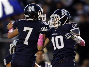 Napoleon QB David Yunker (7) celebrates after throwing a touchdown pass to Nick George (10).