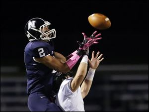 Napoleon WR Jordan Lauf (2) makes a catch against  Perrysburg QB Steve Slocum (1).