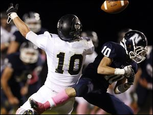 Napoleon C Nick George (10) breaks up a pass intended for Perrysburg WR  Austin Lee (10).