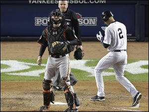 New York Yankees' Derek Jeter scores on an RBI double by Ichiro Suziki during the sixth inning today at Yankee Stadium in New York.