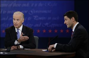 Vice President Joe Biden and Republican vice presidential nominee Paul Ryan, of Wisconsin, speak Thursday during the vice presidential debate at Centre College in Danville, Ky.