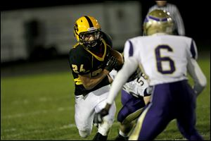 Preston McCurdy, of the Northview Wildcats, runs the ball during the during the second quarter of their game against the The Maumee Panthers.