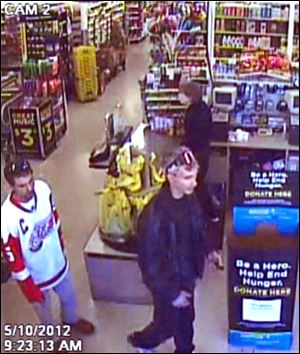 Toledo Police are attempting to identify two suspects attempting to use a stolen credit card that was taken from a motor vehicle.