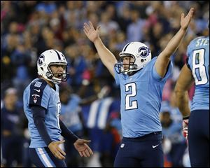 Tennessee Titans kicker Rob Bironas (2) reacts with holder Brett Kern after kicking the game-winning field goal against the Pittsburgh Steelers on Thursday night in Nashville.
