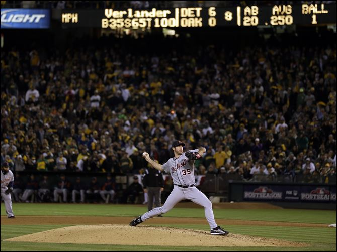Detroit Tigers starting pitcher Justin Verlander delivers a pitch in the eighth inning of Game 5 Thursday night against the Oakland Athletics in Oakland, Calif.
