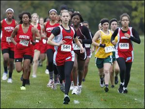 Bowsher's Shauna Plath leads the field for most of the race but ends up taking 2nd during the City League girls cross country race at Collins Park Golf Course in Toledo.